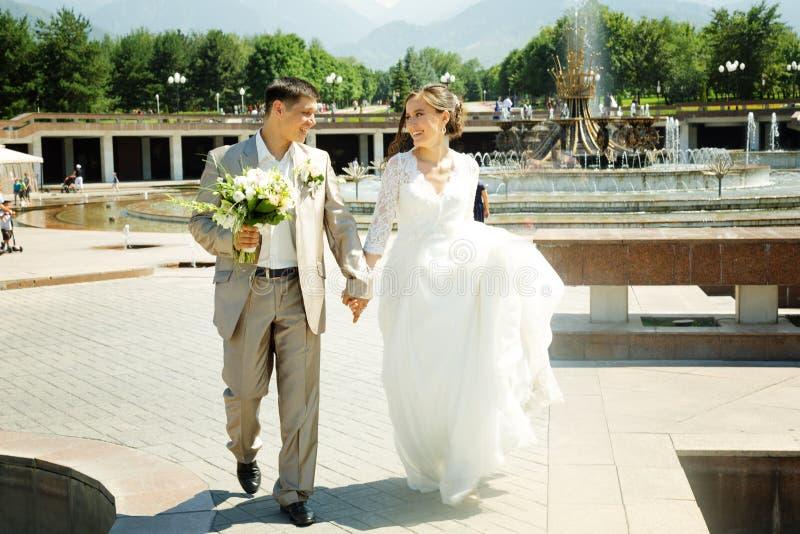 Beautiful happy bride and groom stock photos