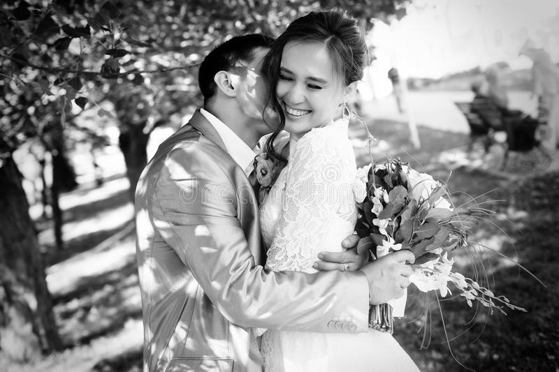 Beautiful happy bride and groom stock images