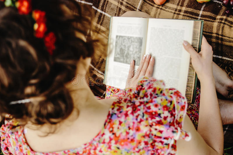 Beautiful happy bride and stylish retro groom, reading books and stock images