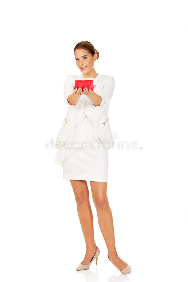 Beautiful happy businesswoman holding red wallet stock photos