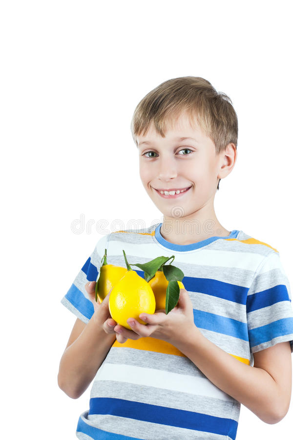 Beautiful happy child in stylish t-shirt holds colorful freshly picked lemons stock image
