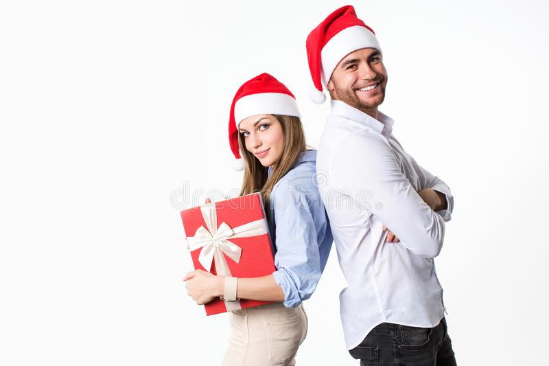 Beautiful happy christmas couple looking at camera. stock image