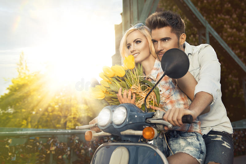 Beautiful happy couple with flowers stock photo