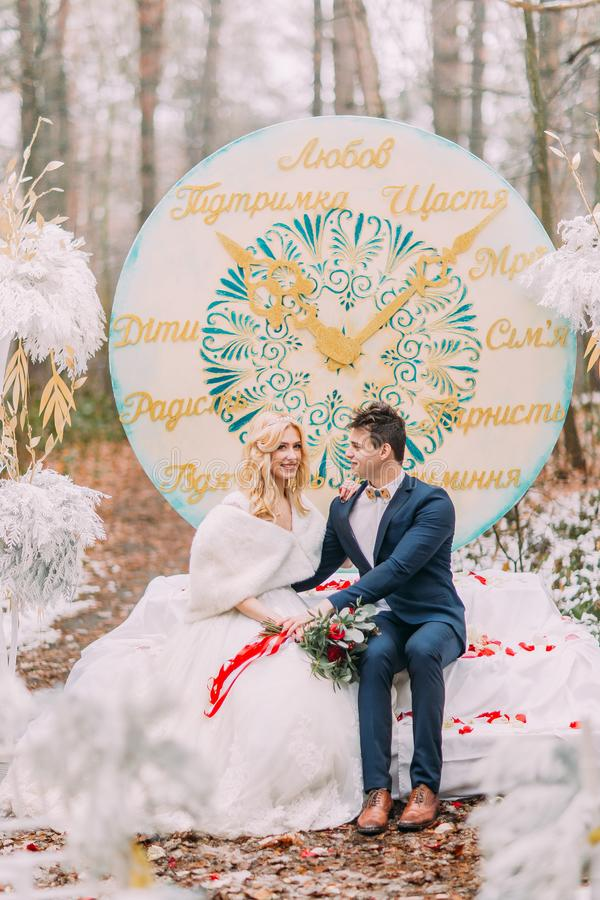 Beautiful happy couple on the wedding ceremony in autumn forest stock photo