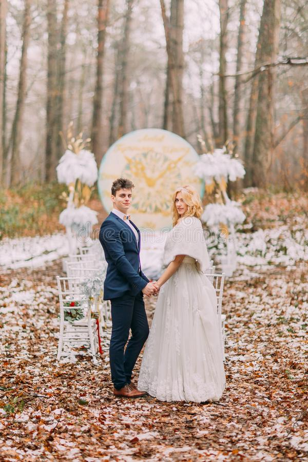 Beautiful happy couple on the wedding ceremony in autumn forest royalty free stock photos