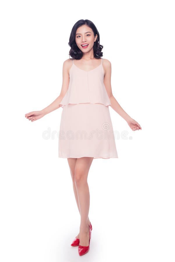 Beautiful happy cute asian woman in casual pink dress with red l. Ips on white background royalty free stock photos