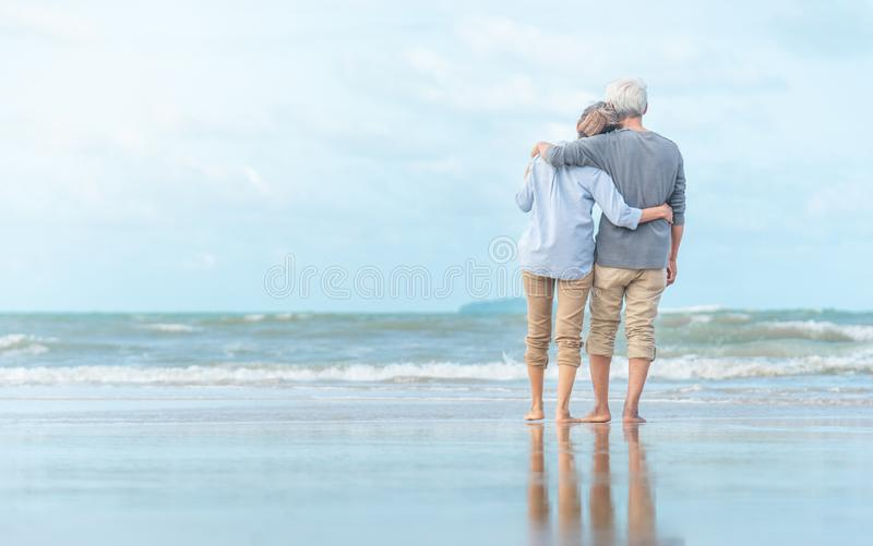 Beautiful happy elderly couple rest at tropical resort,back view royalty free stock image