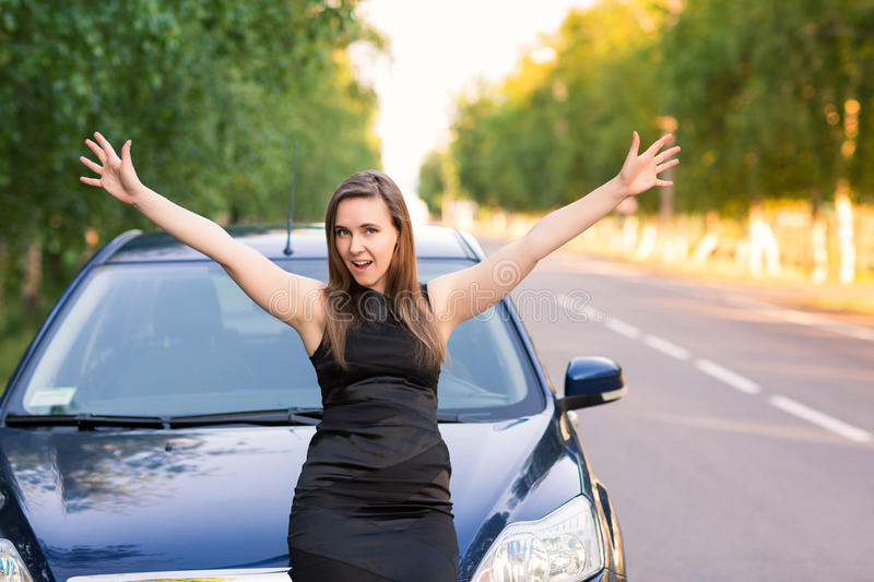 Beautiful happy and excited business woman in her car royalty free stock image