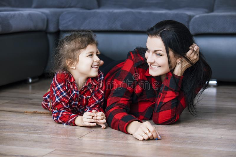 Beautiful happy family mother and daughter smiling together at h stock photo