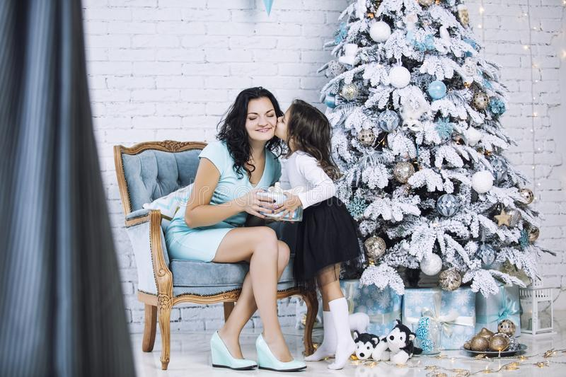 Beautiful happy family mother and daughter to celebrate Christmas and new year together at home royalty free stock image