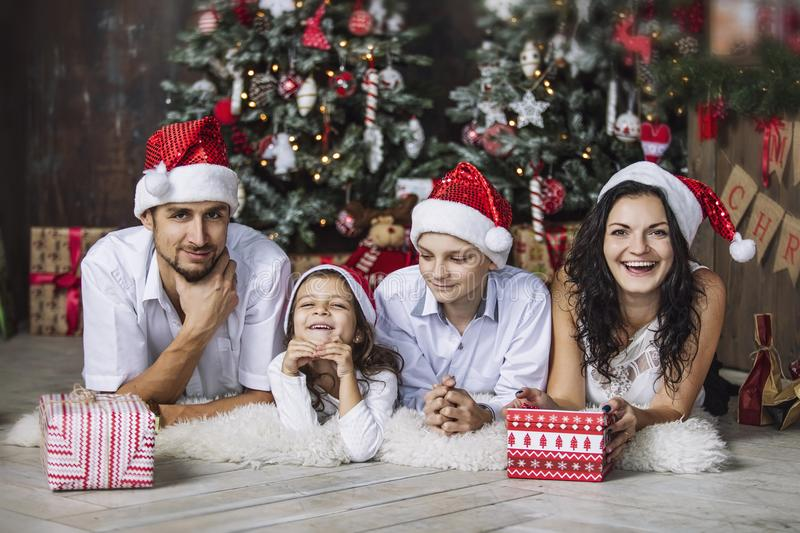 Beautiful happy family mother, father, son, and daughter to celebrate Christmas and new year together at home stock images