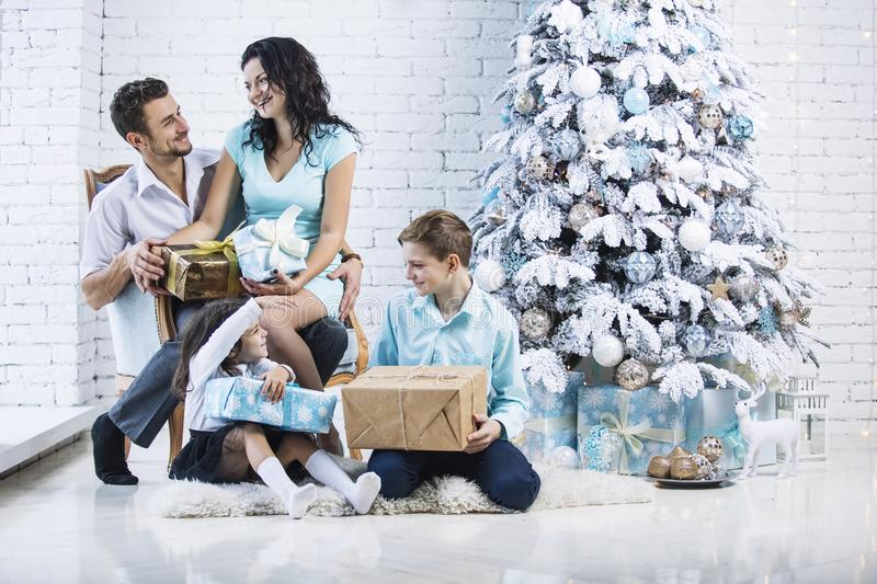 Beautiful happy family mother, father, son, and daughter to celebrate Christmas and new year together at home stock image