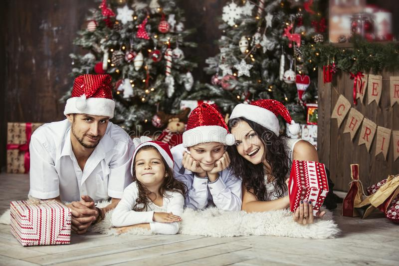 Beautiful happy family mother, father, son, and daughter to celebrate Christmas and new year together at home royalty free stock images