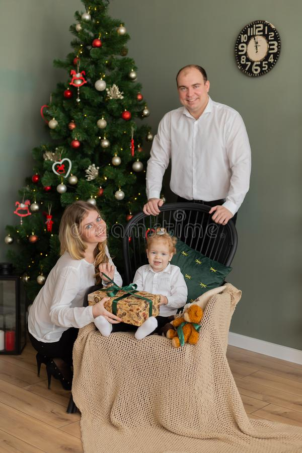 Beautiful happy family at the New Year tree. stock image