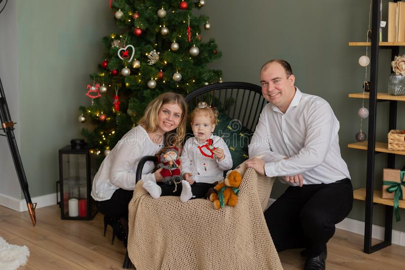 Beautiful happy family at the New Year tree. stock photography