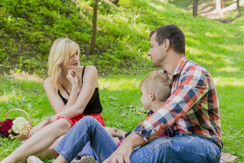 Beautiful happy family resting on a picnic on a sunny day. Beautiful happy family resting on a picnic on a sunny day stock photos