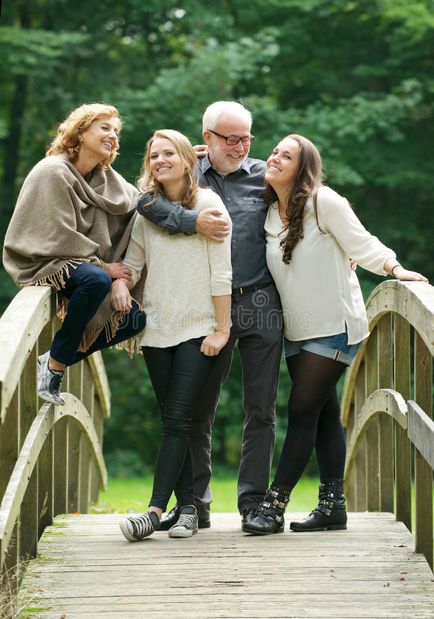 Download Beautiful Happy Family Standing Together In A Bridge In The Woods Stock Image - Image: 34058421