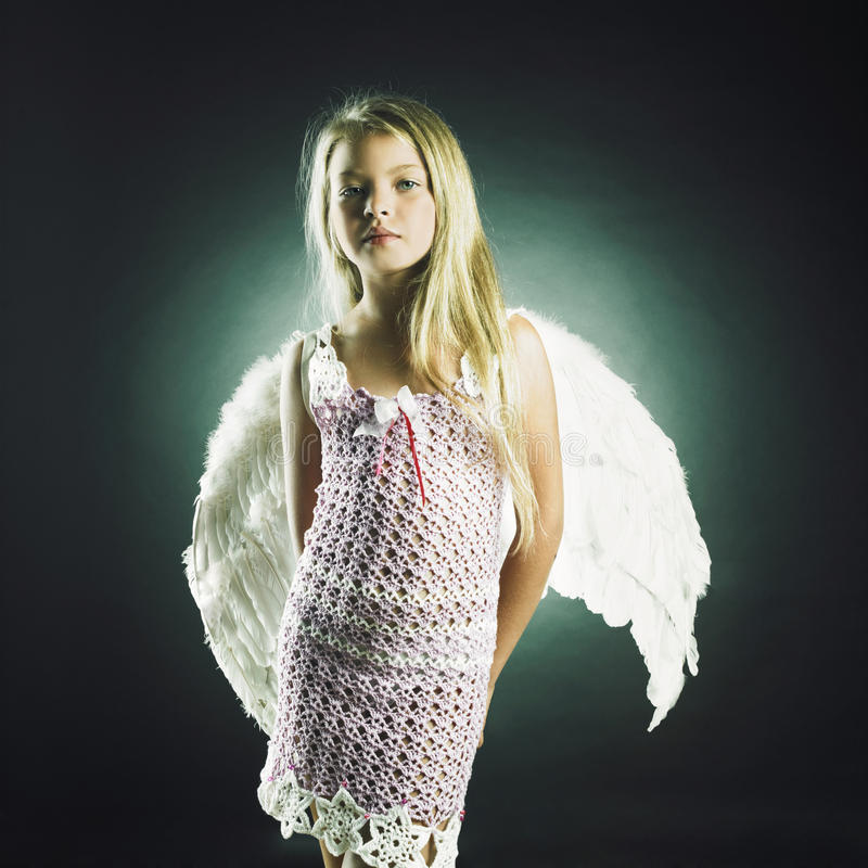 Beautiful happy girl with angel wings royalty free stock photography