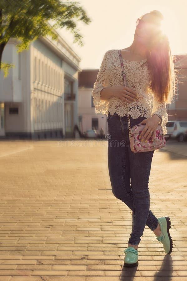 Beautiful happy girl gentle walks through the city nazakate sunglasses , sun chamber gentle toning stock photo