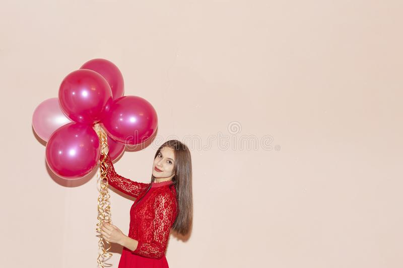 Beautiful and happy girl holds air balloons. valentines day, birthday, womens day, anniversary, holiday celebration concept royalty free stock photos