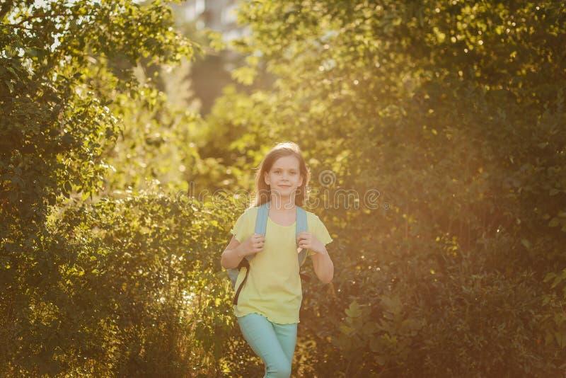 Beautiful happy girl runs outdoors, autumn stock photos
