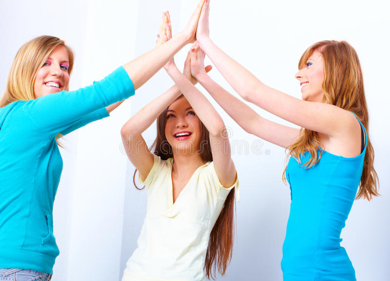 Beautiful happy girls giving five royalty free stock images