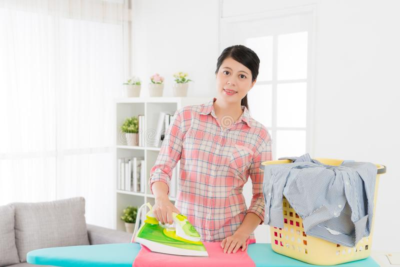 Happy housewife sort out family clean clothing stock photos