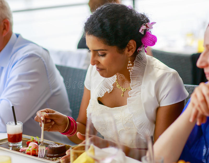Download Beautiful Happy Indian Bride Eating On Wedding Dinner Stock Image