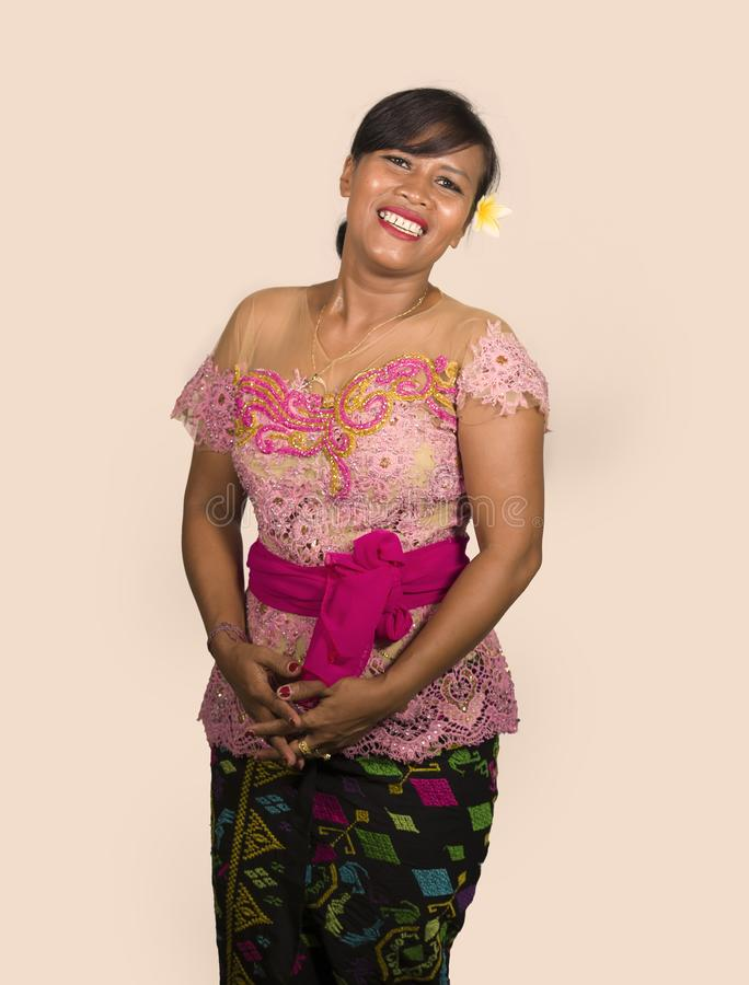Beautiful and happy Indonesian Balinese woman in traditional religious ceremony dress smiling cheerful isolated on studio. Fresh portrait of beautiful and happy stock images