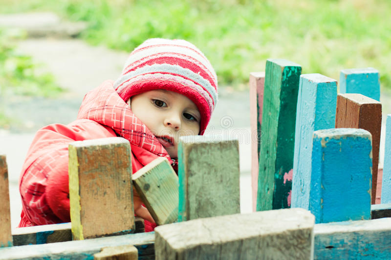 Beautiful happy kid in the red jacket. In the outdoors royalty free stock photos