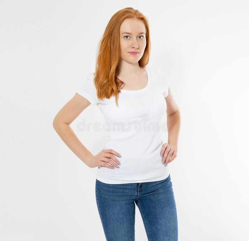 Beautiful happy red hair girl in white t-shirt isolated. Pretty smile red head woman in tshirt mock up, blank royalty free stock images