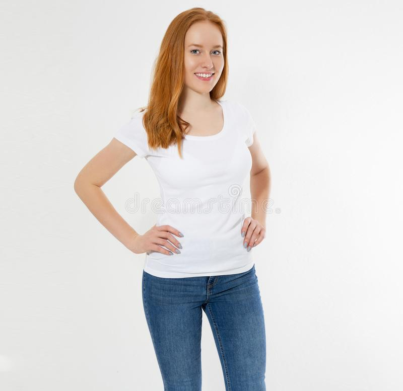 Beautiful happy red hair girl in white t-shirt isolated. Pretty smile red head woman in tshirt mock up, blank stock photography