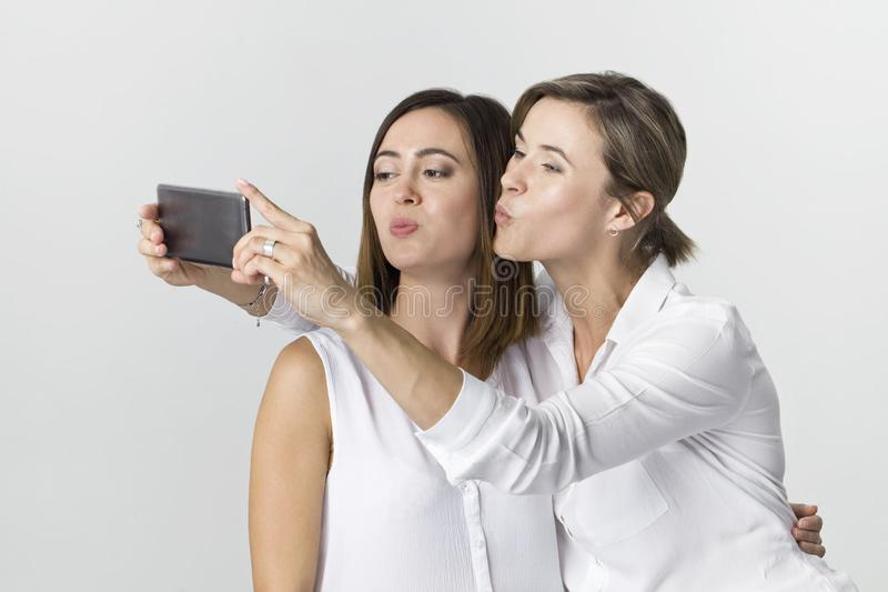 Beautiful happy and smiling female friend making a selfie with k stock photo