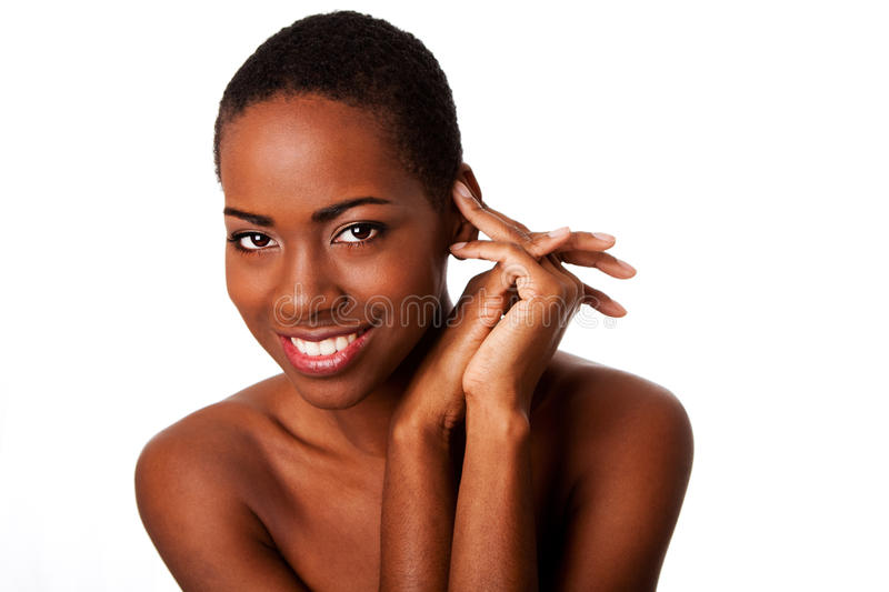 Beautiful happy smiling inspiring African woman. With short curly hair and great skin showing teeth, isolated stock images