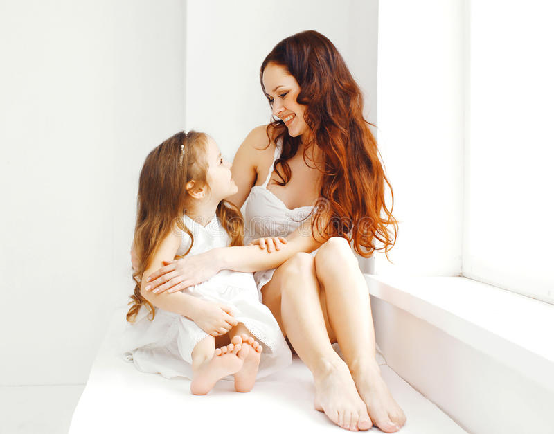 Beautiful happy smiling mother, child daughter at home royalty free stock photography