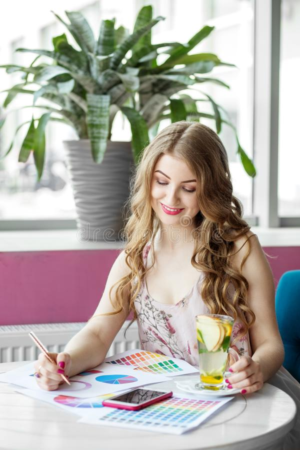 Beautiful happy successful woman working remotely. Citrus tea with mint. The concept of work, business, education, freelance, stock image