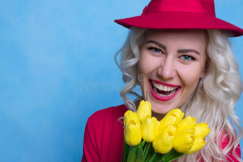 Beautiful Happy Woman with Bouquet of Flowers. Spring Concept. Bright Young Woman with a Bouquet of Tulips. Spring Concept. Copy Space royalty free stock photography