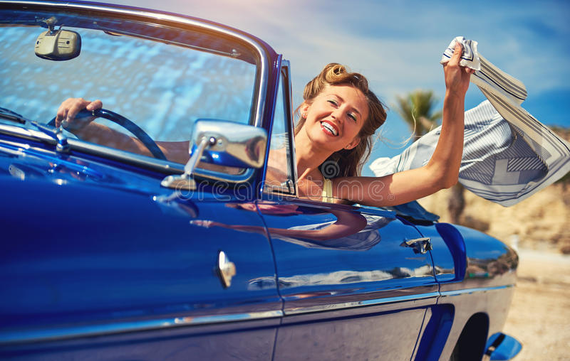 Beautiful happy woman in a car stock photo