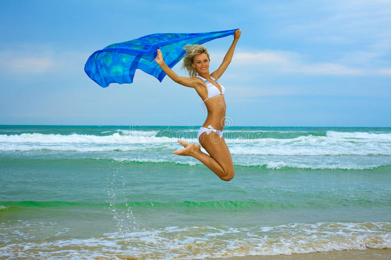 Beautiful happy woman enjoys freedom. On tropical beach royalty free stock images