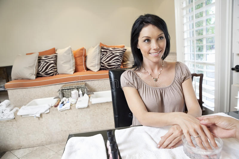 Beautiful happy woman getting herself pampered in beauty spa. Beautiful happy women getting herself pampered in beauty spa stock photography