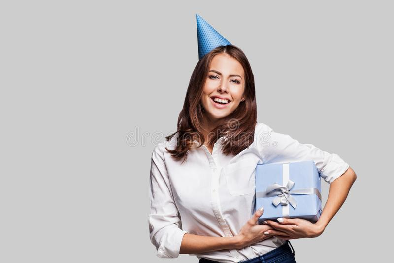 Beautiful happy woman with gift box at celebration party. Birthday or New Year eve celebrating concept royalty free stock image