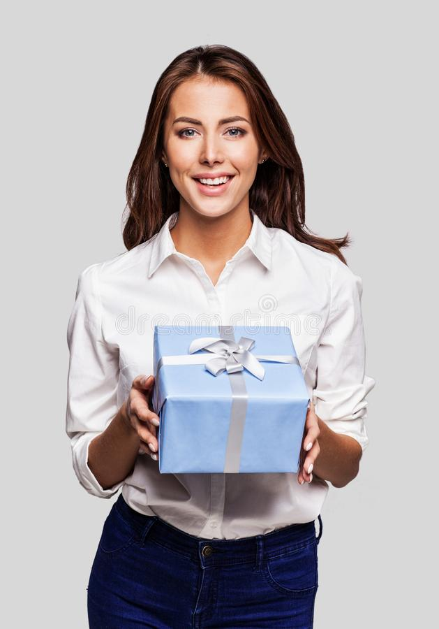 Beautiful happy woman with gift box at celebration party. Birthday or New Year eve celebrating concept royalty free stock images