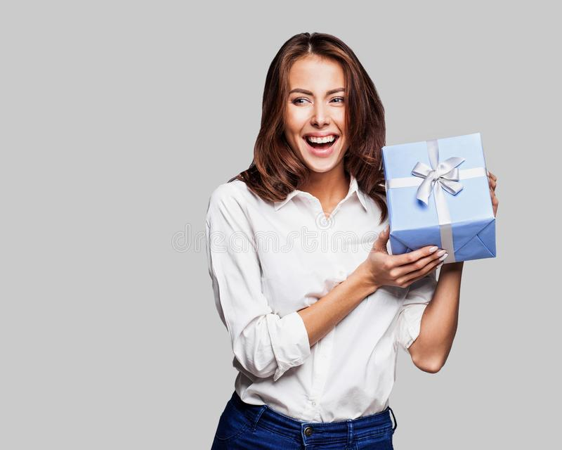 Beautiful happy woman with gift box at celebration party. Birthday or New Year eve celebrating concept stock photos