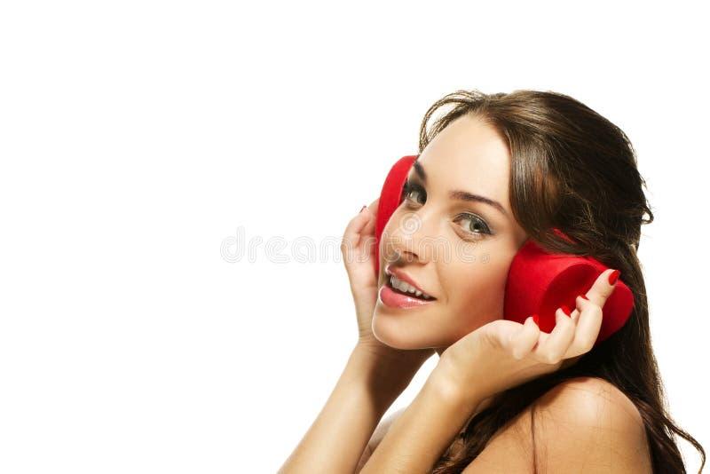 Beautiful happy woman holding red heart shaped box stock photo
