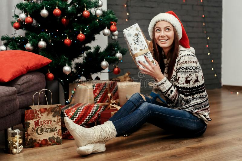 Beautiful happy woman holding surprised christmas present box. g stock images