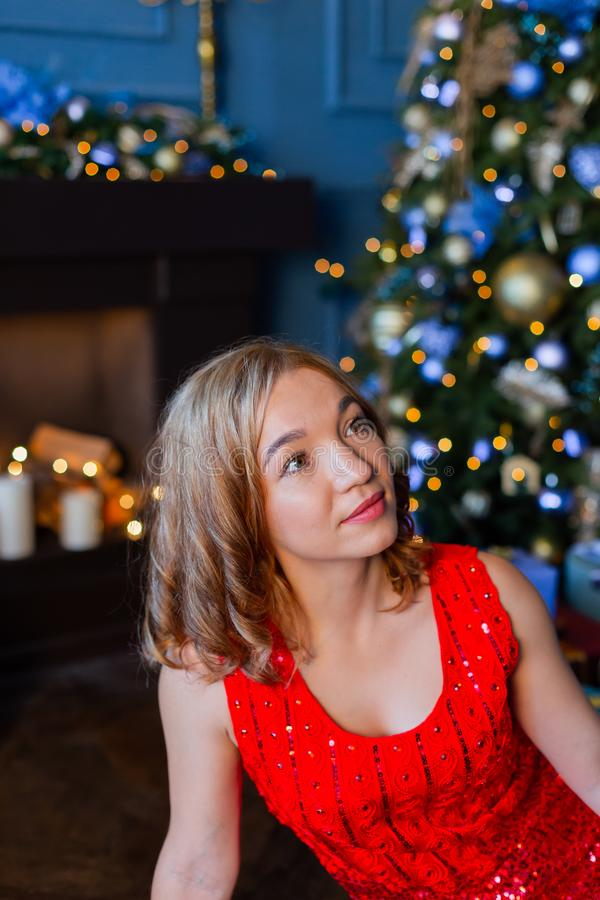 Beautiful happy woman in new year decor. New Year 2020. stock images