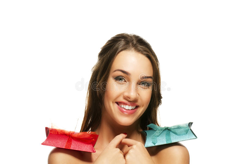 Beautiful happy woman with presents on her shoulde stock photo