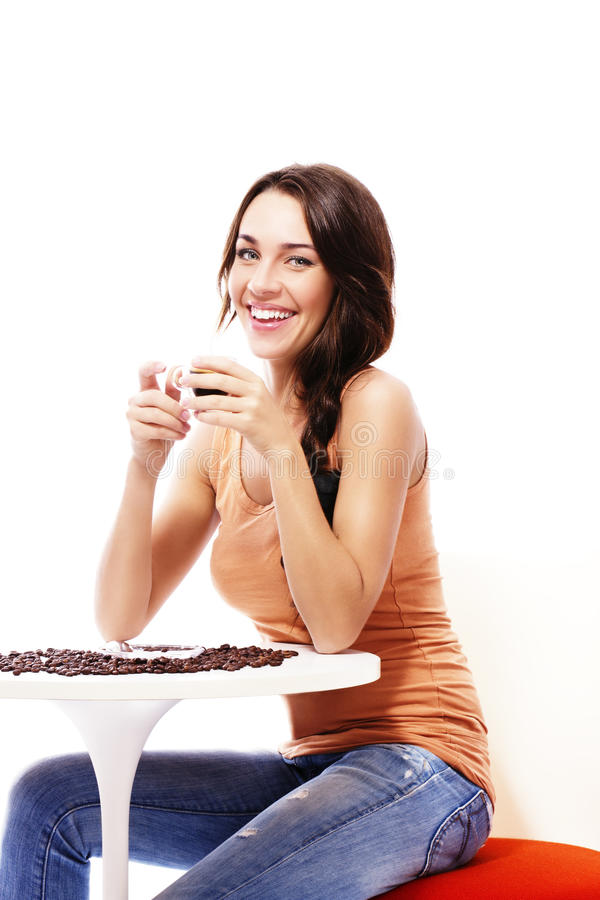 Download Beautiful Happy Woman Sitting On A Table With Espr Stock Photo - Image: 23559650