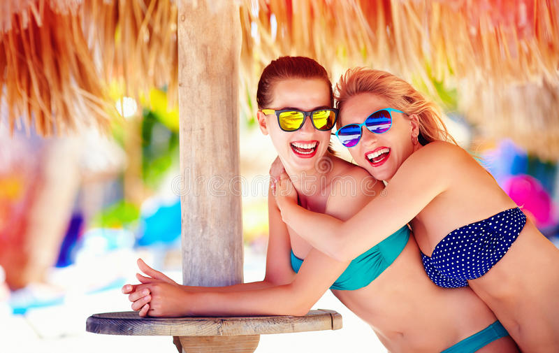 Beautiful happy women, friends enjoy summer vacation on tropical beach royalty free stock image