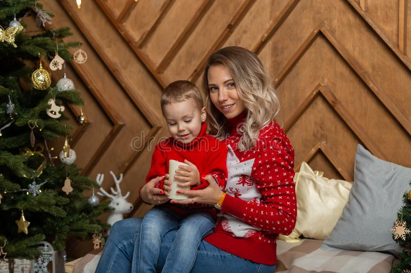 Beautiful happy woman with her son in a New Year`s decor. Happy Merry Christmas 2020. Beautiful happy women with her son in a New Year`s decor. Happy Merry royalty free stock image